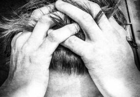 man with hands in his hair